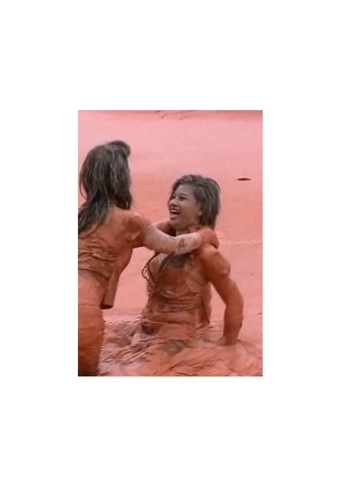 W51 An and Oy in deep orange mud and water (movie)